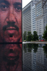 A face of a Chicagoan in the Crown Fountain with some of the buildings along Michigan Ave in the background - Chicago, IL ... September 24, 2006 ... Photo by Rob Page III
