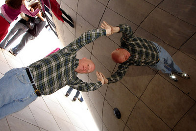 Mr. Conger supports himself inside the Cloud Gate - Chicago, IL ... September 24, 2006 ... Photo by Rob Page III
