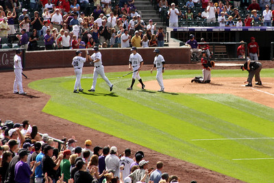 Celebrating Garret Atkins home run - Denver, CO ... September 21, 2008 ... Photo by Rob Page III