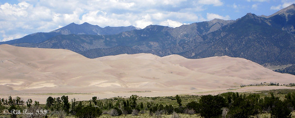 Cleveland and Tijeras Peaks, Music and Marble Mountains rising beyond the dunes - Great Sand Dunes National Park, CO ... July 15, 2006 ... Photo by Rob Page III