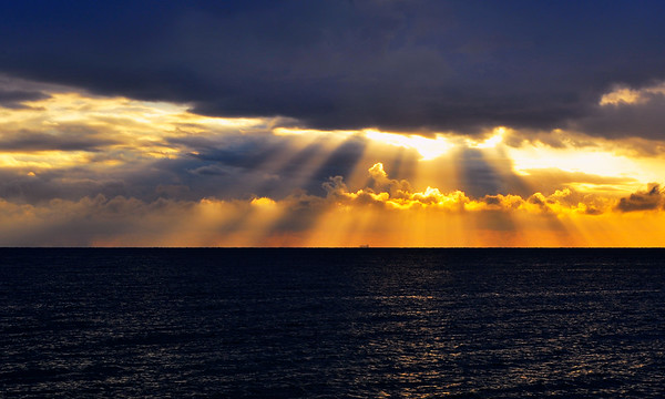 Rays thru clouds and onto water