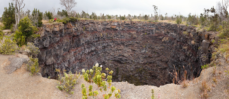 Hawaii, Volcanoes NP - Devil's Throat with woman on edge of cliff