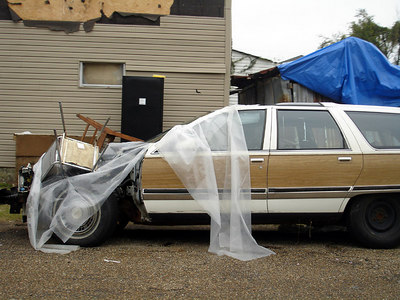 A car in the Central City / Garden District of New Orleans between Simon Bolivar Ave. and St. Charles Ave. - New Orleans, LA ... December 17, 2005 ... Photo by Rob Page III