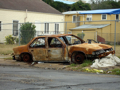 A rusted out car and blue tarps on the roofs  in the Central City / Garden District of New Orleans between Simon Bolivar Ave. and St. Charles Ave. - New Orleans, LA ... December 17, 2005 ... Photo by Rob Page III