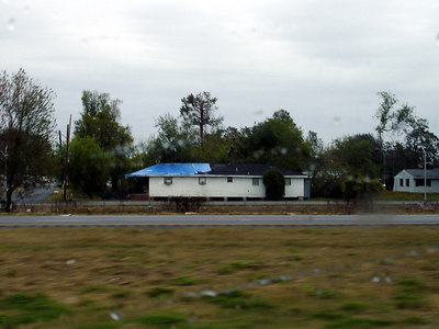 The blue tarps you see on so many roofs as you drive into and around New Orleans - New Orleans, LA ... December 17, 2005 ... Photo by Rob Page III