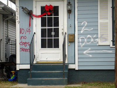 Note the dating of the markers to keep searchers from re-entering the house and wasting precious time.  Additionally, the search was 36 days after the storm.  - New Orleans, LA ... December 17, 2005 ... Photo by Rob Page III