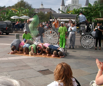 Clearing The Hurdle: Street Performers impress a downtown New Orleans crowd of tourists.