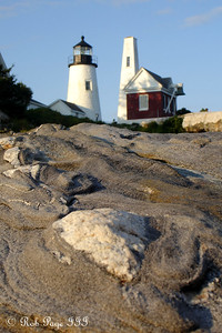 The Pemaquid Point Lighthouse.  This lighthouse is located at the entrance to Muscongus Bay and John Bay.  This point was originally established as a lighthouse in 1827 and the current lighthouse was constructed in 1835.  It is 38 feet tall and sits 79 feet above the ocean - Pemaquid, ME ... August 26, 2006 ... Photo by Rob Page III