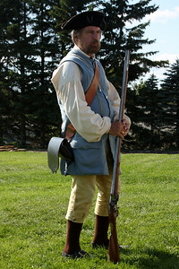 A gentleman dressed in period clothing demonstrating how a musket was fired - Pemaquid, ME ... August 31, 2008 ... Photo by Rob Page III