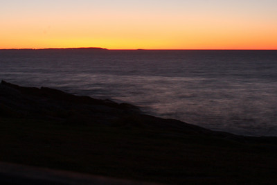 The sun burns the horizon at sunrise - Pemaquid, ME ... September 6, 2009 ... Photo by Rob Page III