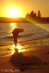 Emily searching for sand dollars - Pemaquid, ME ... September 2, 2007 ... Photo by Rob Page III