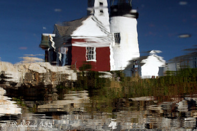 A reflection of the Pemaquid Lighthouse - Pemaquid, ME ... September 6, 2009 ... Photo by Rob Page III