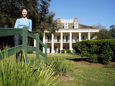 Emily and the main house at the Oak Alley Plantation.  This house was built as a wedding gift by the original owner in the ealry 1800's.  The Oak trees in the front are about 300 years old and lead to the Missippi River - Vacherie, LA ... February 27, 2006 ... Photo by Rob Page III
