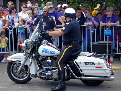 The police officer had previously dropped his bike on its side.  Mardi Gras in the country! - Eunice, LA ... February 28, 2006