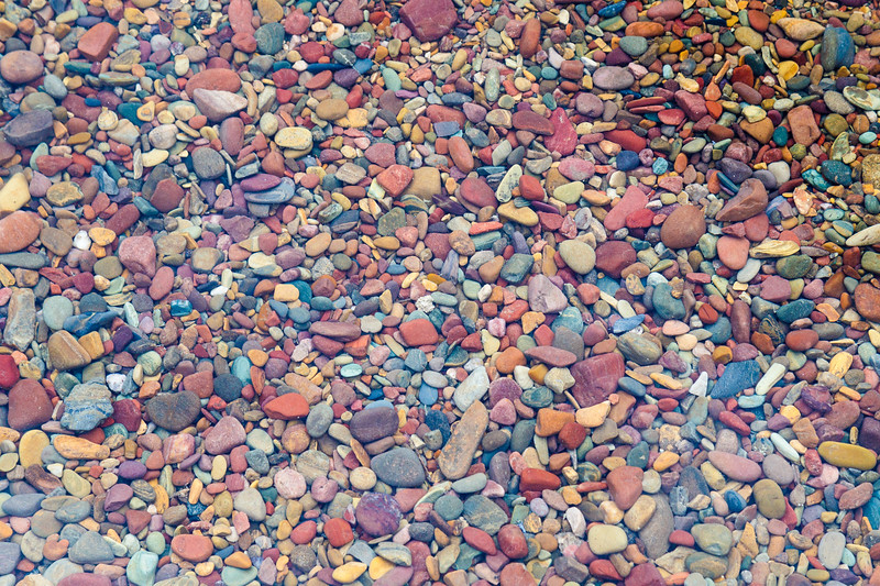 Glacier, Lake McDonald - Colorful rocks on the shore of the lake