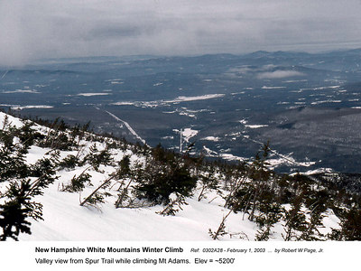 Ref:  0302A28 - February 1, 2003 by Robert W Page, Jr. New Hampshire White Mountains Winter Climb. Valley view from Spur Trail while climbing Mt Adams.  Elev = ~5200'