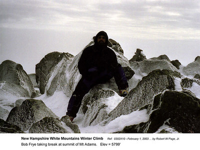 Ref: 0302X10  February 1, 2003 by Robert W Page Jr  (Bob Frye negative) New Hampshire - White Mountains Winter Climb. Bob Frye taking break at summit of Mt Adams.   Elev = 5799'