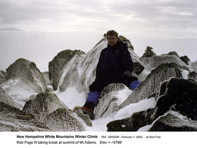 Ref: 0302X11  February 1, 2003 by Bob Frye  (Bob Frye negative) New Hampshire - White Mountains Winter Climb. Rob page III taking break at summit of Mt Adamsl.   Elev = 5799'