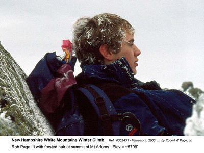 Ref:  0302A33 - February 1, 2003 by Robert W Page, Jr. New Hampshire White Mountains Winter Climb. Rob Page III with frosted hair at summit of Mt Adam.  Elev = ~5799'