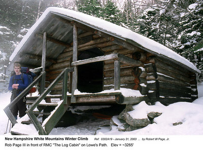 """Ref:  0302A19 - January 31, 2003 by Robert W Page, Jr. New Hampshire White Mountains Winter Climb. Rob Page III in front of RMC """"The Log Cabin"""" on Lowe's Path.   Elev = ~3265'"""