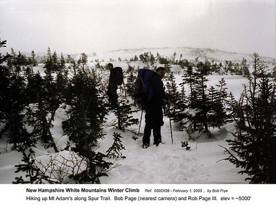 Ref: 0302X06  February 1, 2003 by Bob Frye  (Bob Frye negative) New Hampshire - White Mountains Winter Climb. Hiking up Mt Adam's along Spur Trail.  Bob Page (nearest camera) and Rob Page III.  elev = ~5000'