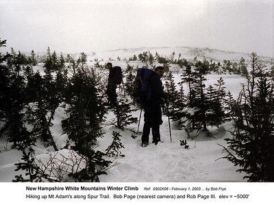 Ref: 0302X06  February 1, 2003 by Bob Frye  (Bob Frye negative) New Hampshire - White Mountains Winter Climb. Hiking up Mt Adam's along Spur Trail.  Bob Page (nearest camera) and Rob Page III.  elev = ~5000'