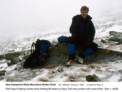 Ref:  0302A32 - February 1, 2003 by Robert W Page, Jr. New Hampshire White Mountains Winter Climb. Rob Page III taking a break while climbing Mt Adams on Spur Trail near junction with Lowe's Path.  Elev = ~5425'