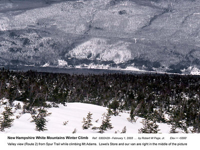 Ref:  0302A29 - February 1, 2003 by Robert W Page, Jr. New Hampshire White Mountains Winter Climb. Valley view (Route 2) from Spur Trail while climbing Mt Adams.  Lowe's Store and our van are right in the middle of the picture.  Elev = ~5300'
