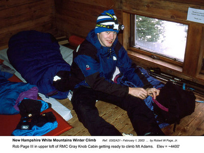 Ref:  0302A21 - February 1, 2003 by Robert W Page, Jr. New Hampshire White Mountains Winter Climb. Rob Page III in upper loft of RMC Gray Knob Cabin getting ready to climb Mt Adams.   Elev = ~4400'