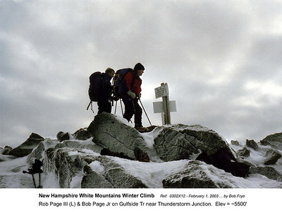 Ref: 0302X12  February 1, 2003 by Bob Frye  (Bob Frye negative) New Hampshire - White Mountains Winter Climb. Rob Page III (left) and Bob Page Jr next to trail marker near Thunderstorm Junction  Elev = ~5500'