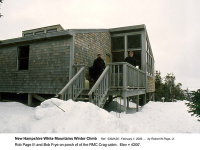 Ref:  0302A25 - February 1, 2003 by Robert W Page, Jr. New Hampshire White Mountains Winter Climb. Rob Page III and Bob Frye on porch of of the RMC Crag cabin.  Elev = 4200'.