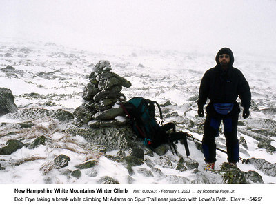 Ref:  0302A31 - February 1, 2003 by Robert W Page, Jr. New Hampshire White Mountains Winter Climb. Bob Frye taking a break while climbing Mt Adams on Spur Trail near junction with Lowe's Path.  Elev = ~5425'