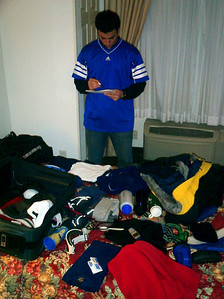 Pedro Mendoza making sure that he has everything before we go up into the mountains - Manchester, New Hampshire ... February 11, 2005 ... Photo by Rob Page III