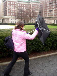 Christine Bell having toruble with her umbrella at Columbia University - January 3, 2006 ... New York, NY ... Photo by Rob Page III