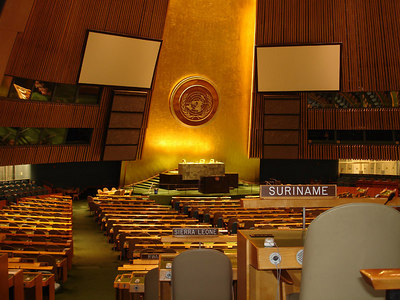 The General Assembly: The General Assembly Hall is the largest room in the United Nations, with seating capacity for over 1,800 people. The design of the room was a collaborative effort by the team of 11 architects that designed Headquarters, and to emphasize the international character of the room it contains no gift from any Member State. The only gift in the General Assembly is anonymous: two abstract murals on each side of the Hall - designed by the French artist Fernand Leger - were given by an unnamed donor through the United Nations Association of the United States. - New York, NY ... January 2, 2006 ... Photo by Rob Page III