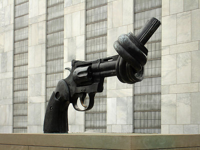 Non-Violence is a giant revolver, solid and black, and on a pedestal placing it at eye level. The barrel of the gun is twisted into a knot, causing the tip to point straight up into the sky rather than in the direction in which it is aimed. The gun is cocked, but the knot makes it clear that it will not shoot. - New York, NY ... January 2, 2006 ... Photo by Rob Page III
