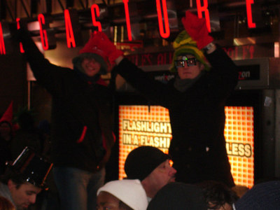 Celebrating in Times Square - New York, NY ... December 31, 2005 ... Photo by Rob Page III
