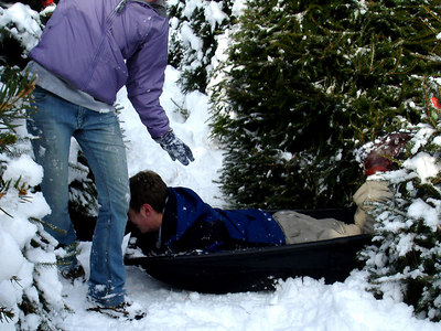 Rob sledding to knock over Heather - Novelty, OH ... November 26, 2005 ... Photo by Rob Page Jr.