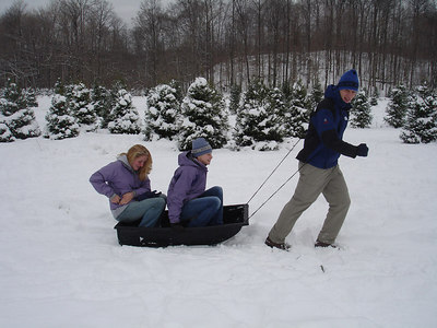 Rob pulling Heather and Emily while getting our Christmas tree - Novelty, OH ... November 26, 2005 ... Photo by Rob Page Jr