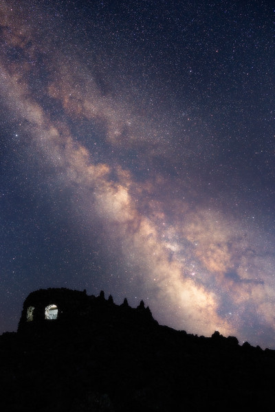 Central, Dee Wright - Stone observatory with lit window under the Milky Way