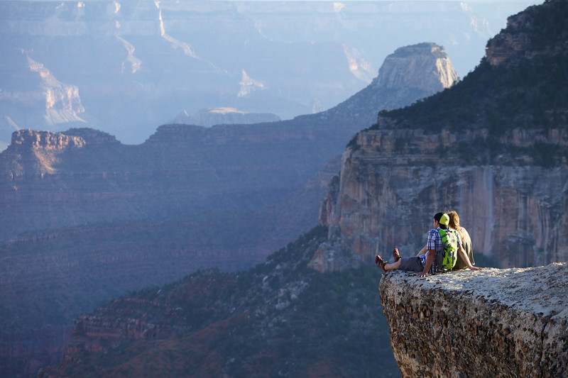 A couple take up a precarious viewpoint on the Grand Canyon's North Rim