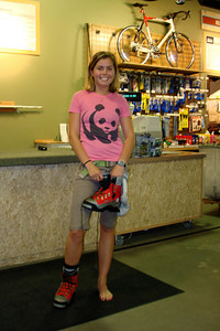 Nicole tries her boot on.  Not exactly runway attire - Portland, OR ... June 27, 2007 ... Photo by Joyce Page
