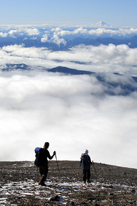 Emily and Jen working their way down the mountain with Mt. Hood in the distance - Mt. St. Helens, WA ... June 30, 2007 ... Photo by Rob Page III