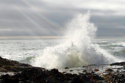 A wave erupts through a ray of sunshine - Oregon ... July 2, 2007 ... Photo by Rob Page Jr.