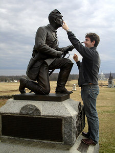 Dermot, playing with the First Pennsylvania Cavalry statue - Gettysburg, PA ... January 21, 2006 ... Photo by Rob Page III