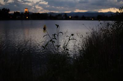 The sun sets over Berkeley Lake Park in northwest Denver, Colorado.