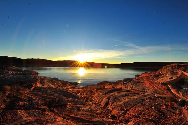 Sun on horizon on Lake Powell