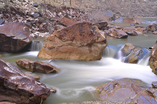 Boulders in River with misted water