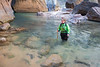 Zion, The Narrows - Hiker finding her way through a deep section of river