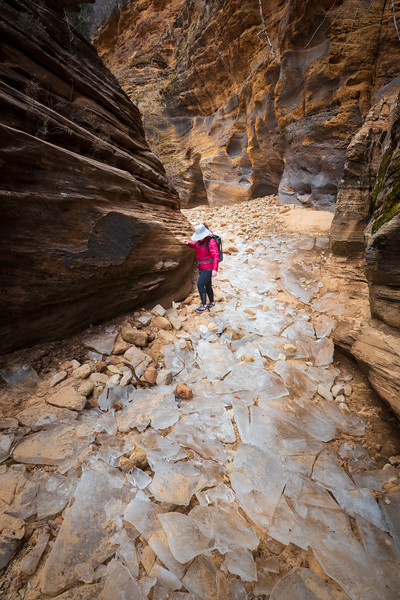 Zion, Clear Creek - Woman navigating large ice blocks